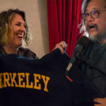 Shannon Jackson, associate vice chancellor of art and design, presents alum and director Stan Lai with a Berkeley sweatshirt at a pre-opera event in the Dress Circle Lounge at the San Francisco Opera House. (UC Berkeley photo by Kyle Ludowitz)